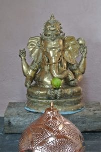 An apple offering to ganesh
