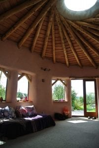 Inside ty mam mawr straw bale roundhouse the roof and central skylight is a vortex to the higher realms