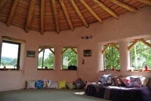Sunny outside....warm and pink inside ty mam mawr straw bale roundhouse