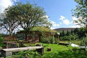 The fire pit and roundhouse at ty mam mawr off grid eco retreat centre