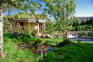 Ty mam mawr eco retreat centre roundhouse and yurt from behind pond
