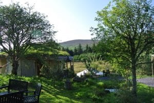 Ty mam mawr eco retreat centre straw bale round house and mongolian yurt looking out at moel y henfaes in north wales