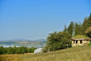 Ty mam mawr straw bale roundhouse and yurt view to west with arenig fawr in sight