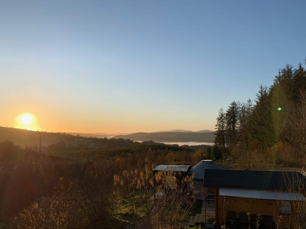 A clear winters sunset over ty crwn bach idris off grid sustainable eco glampsite and glamping