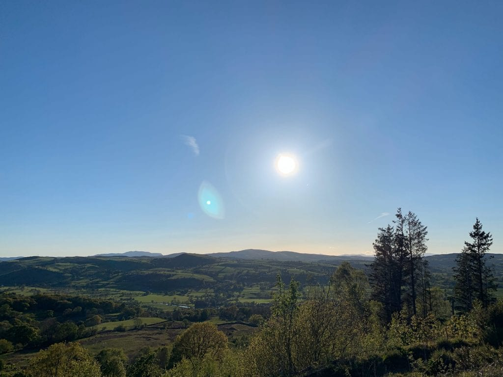 A sunny may afternoon in the dee valley looking out at arenig fawr from just above ty mam mawr eco retreat centre off grid sustainable eco glampsite and glamping