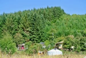 A view of both yurts from the field 1 off grid sustainable eco glampsite and glamping