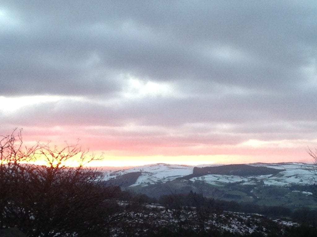 A wintry sunset off grid sustainable eco glampsite and glamping