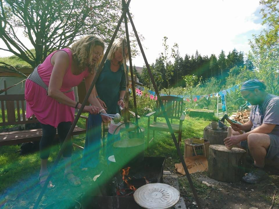 Camp fire cooking and sppon carving off grid sustainable eco glampsite and glamping