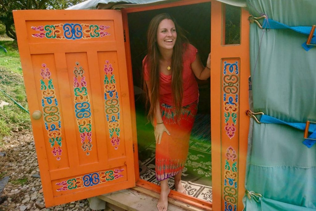 Guest coming out of ty crwn mawr off grid sustainable eco glampsite and glamping