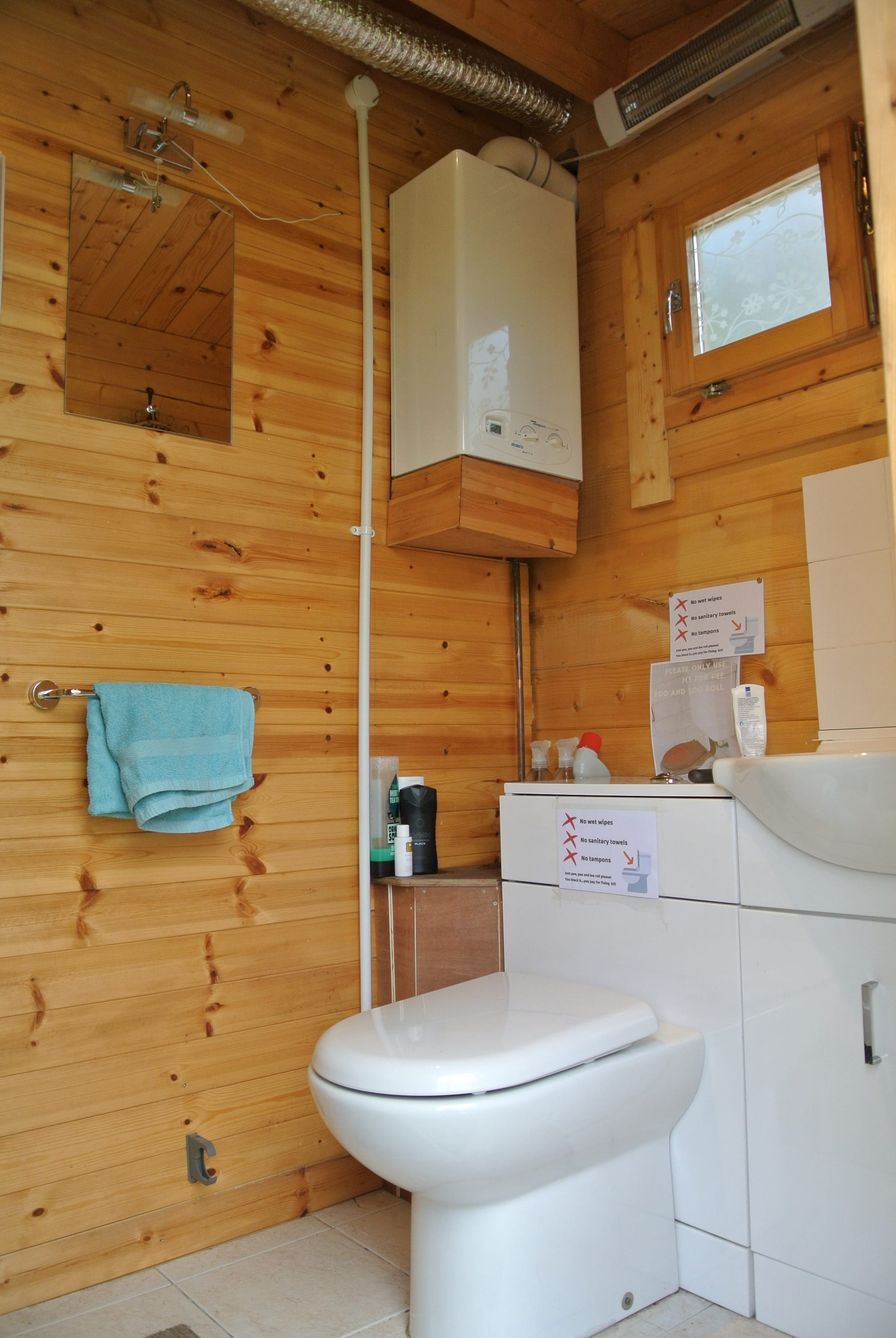 Log cabin bathroom flushing loo and sink off grid sustainable eco glampsite and glamping