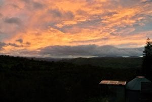 Spring sunset over ty crwn bach idris off grid sustainable eco glampsite and glamping