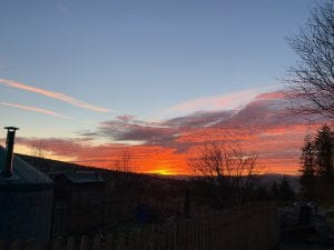 Sunset outside the small yurt off grid sustainable eco glampsite and glamping