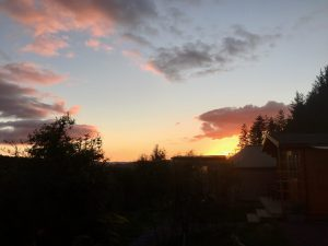 Sunset over ty crwn bach idris off grid sustainable eco glampsite and glamping
