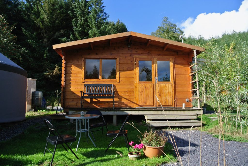Ty Log - The log cabin kitchen and bathroom - off grid sustainable eco glampsite and glamping