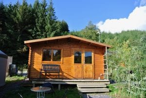 The log cabin kitchen and bathroom off grid sustainable eco glampsite and glamping