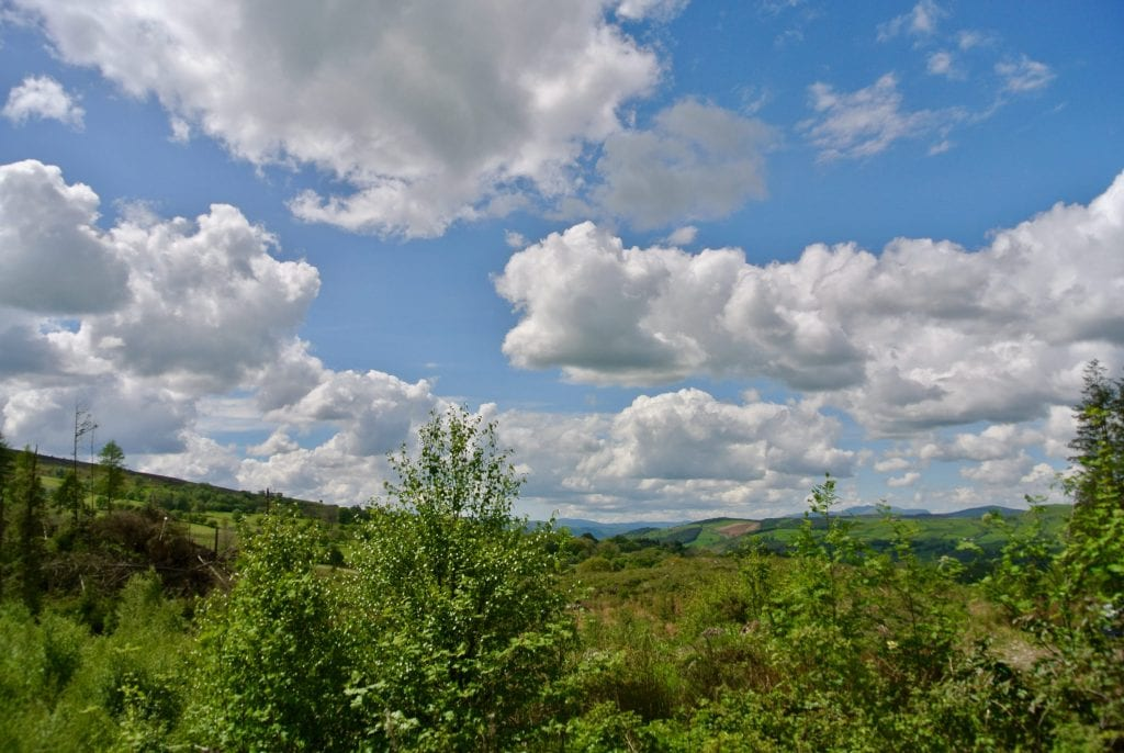 The view out over the Dee Valley to Snowodonia fron Th Crwn Idris Bach yurt at Ty Mam Mawr off grid eco retreat centre