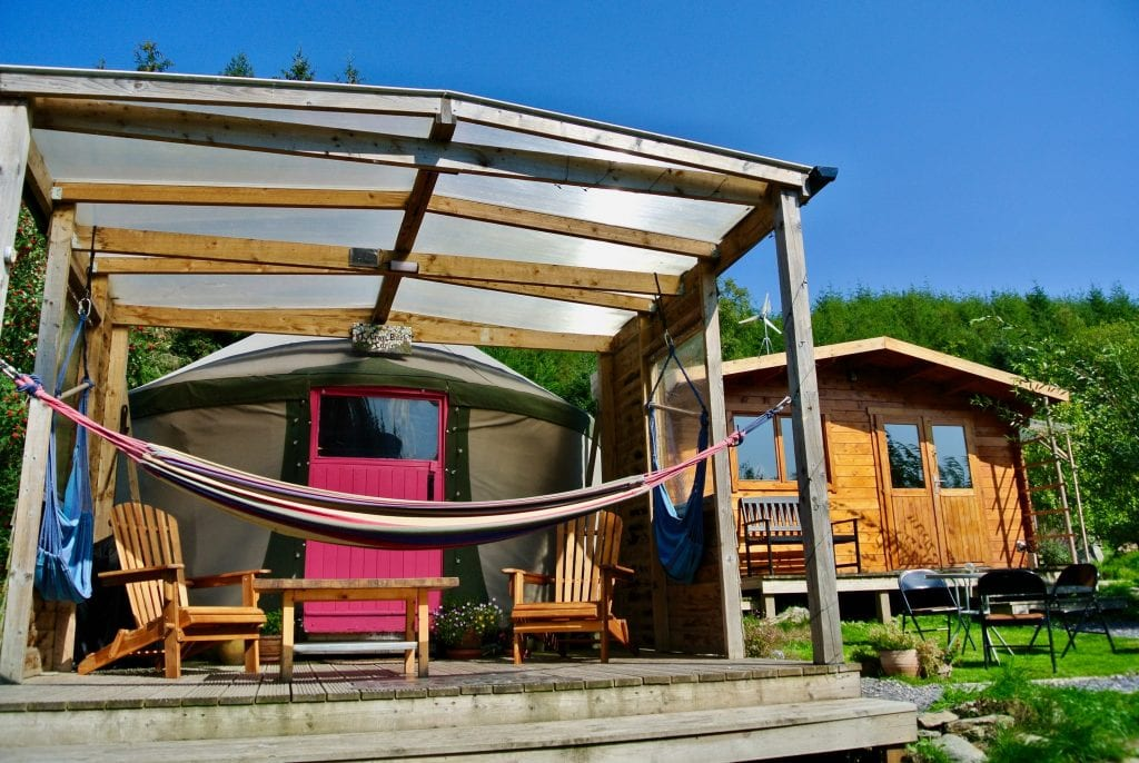 Ty Crwn Bach Idris Yurt - Covered deck with seats and hammocks - Off Grid Sustainable Eco Glampsite And Glamping