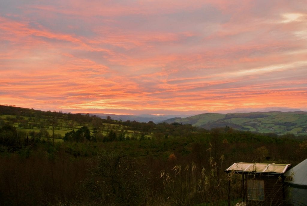 Ty crwn bach idris yurt red evening sky 1 off grid sustainable eco glampsite and glamping