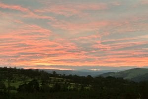 Ty crwn bach idris yurt red evening sky off grid sustainable eco glampsite and glamping