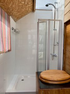 Ty crwn mawr yurt bathroom compost loo and hot shower off grid sustainable eco glampsite and glamping