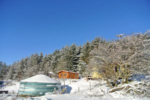 Ty crwn mawr yurt in the snow off grid sustainable eco glampsite and glamping