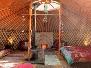 Ty crwn mawr yurt inside off grid sustainable eco glampsite and glamping