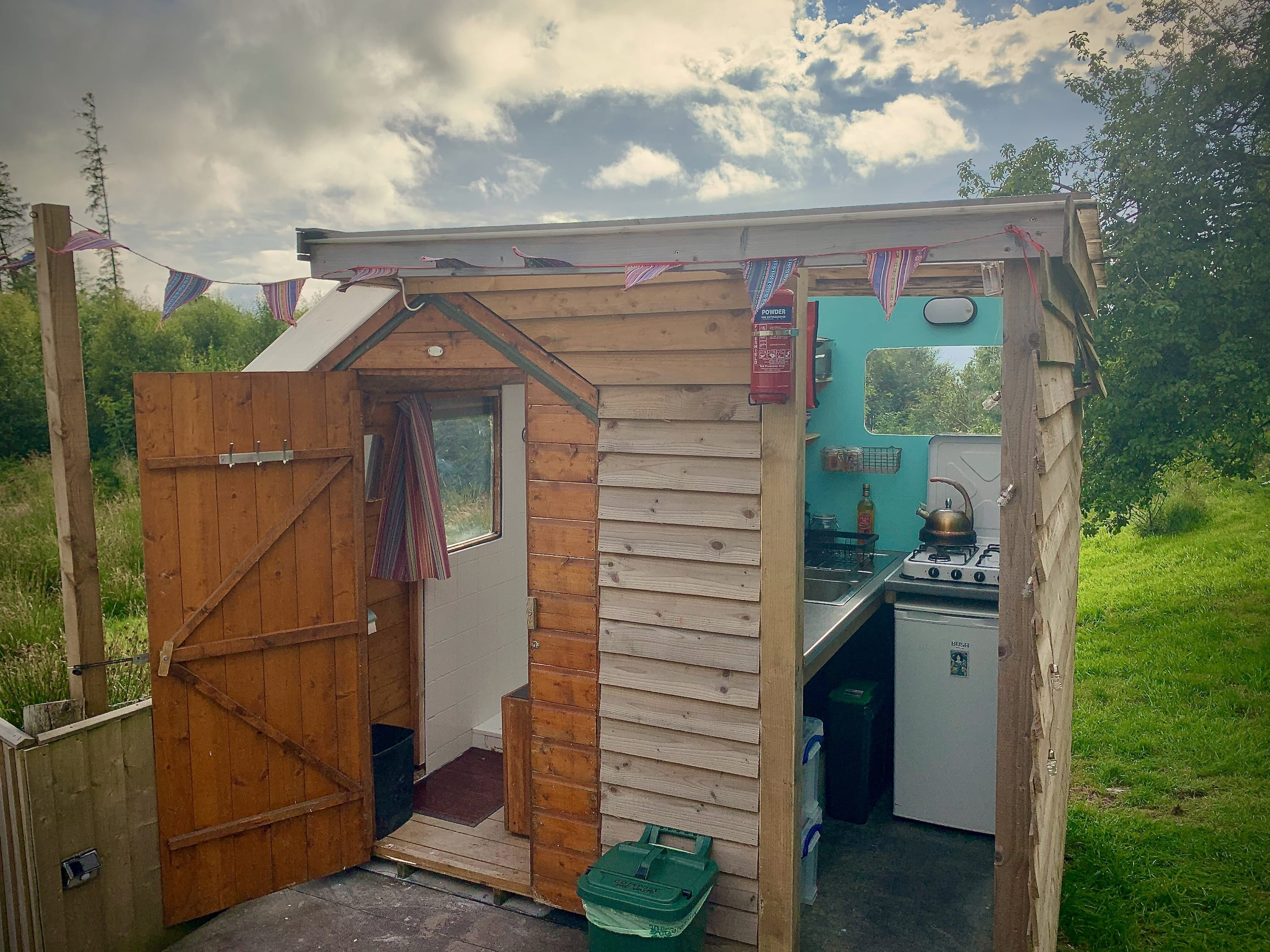 Ty crwn mawr yurt kitchen and bathroom off grid sustainable eco glampsite and glamping