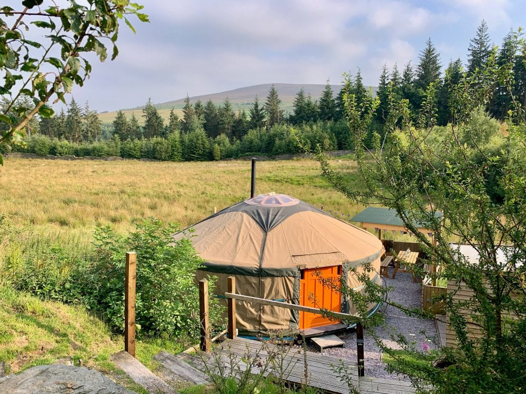 Ty crwn mawr yurt outside new cover 1 off grid sustainable eco glampsite and glamping