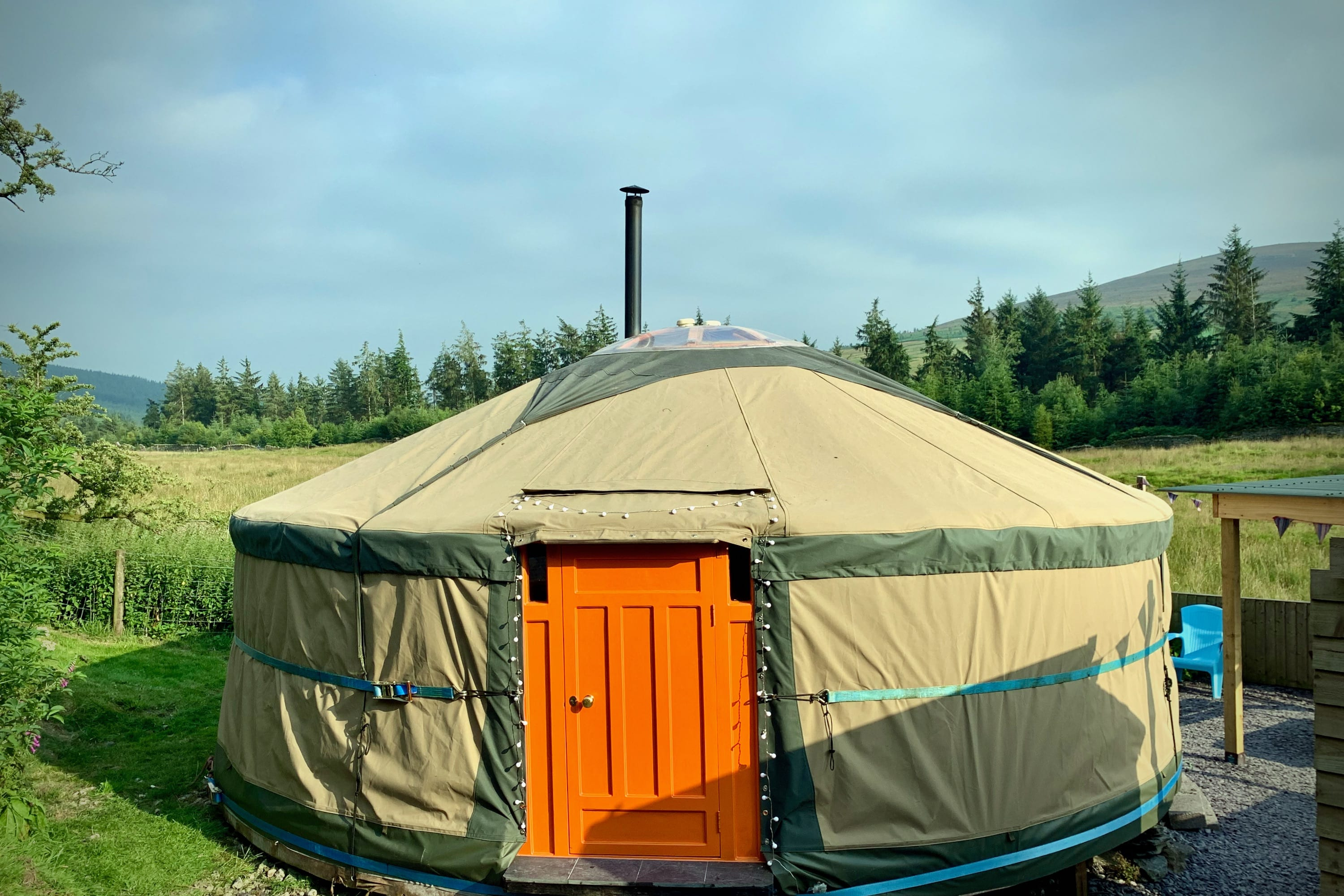 Ty crwn mawr yurt outside new cover 2 off grid sustainable eco glampsite and glamping