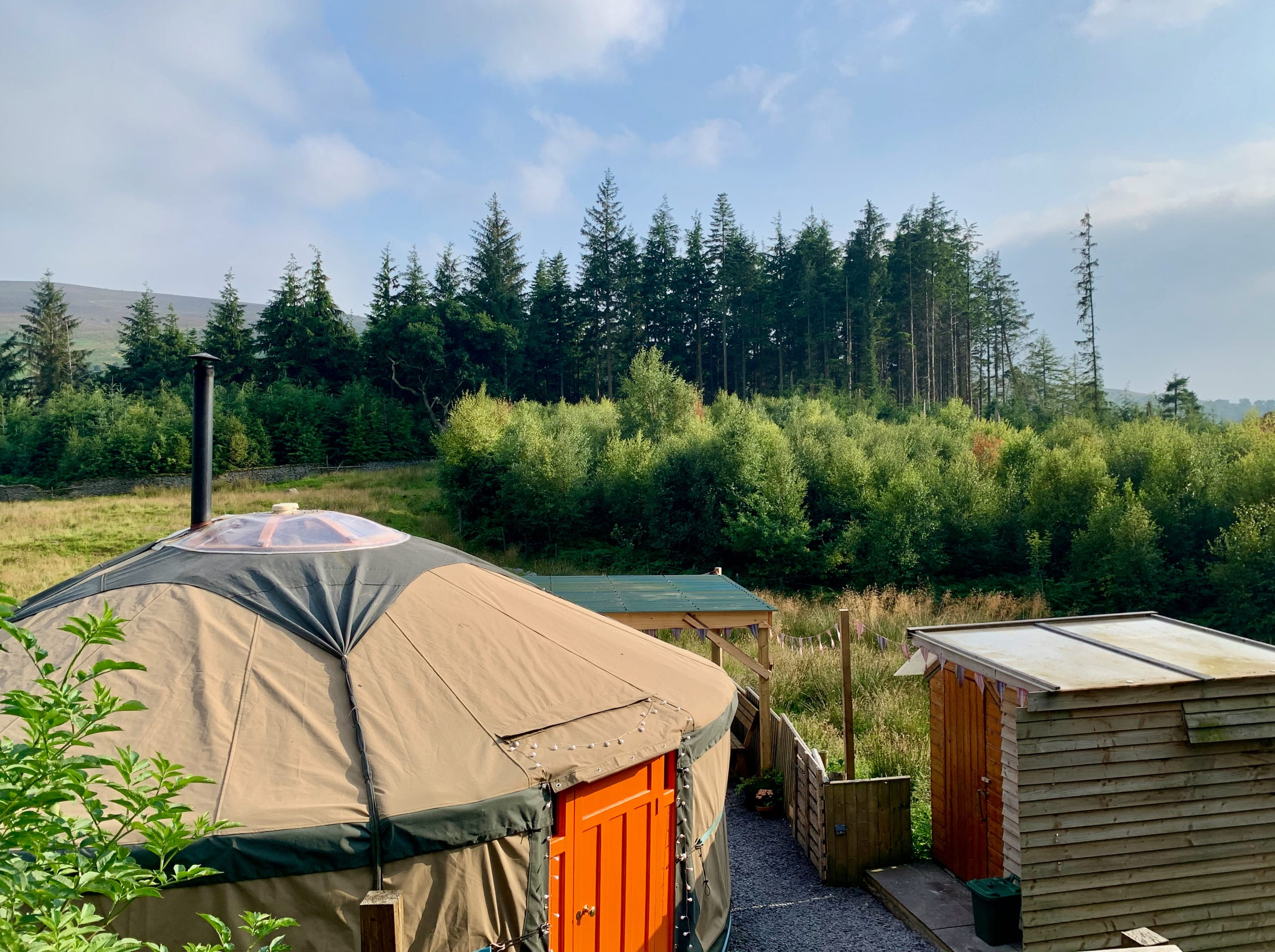 Ty crwn mawr yurt outside new cover 3 off grid sustainable eco glampsite and glamping