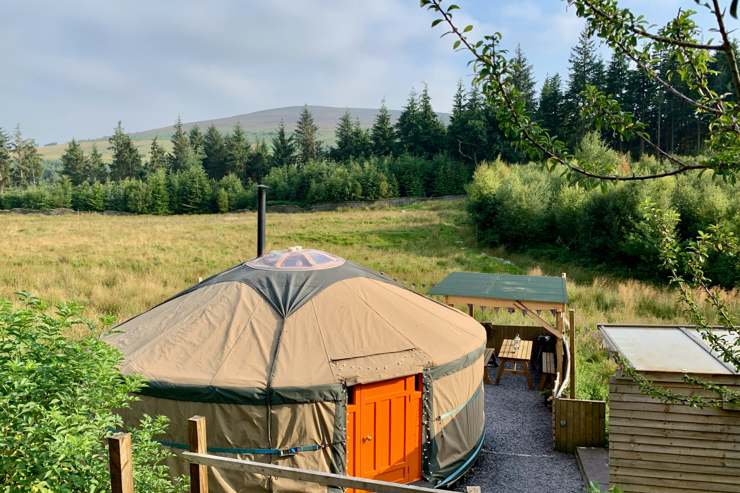 Ty crwn mawr yurt outside new cover 4 off grid sustainable eco glampsite and glamping