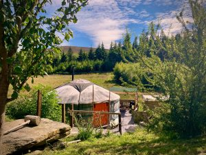 Ty crwn mawr yurt outside old cover 1 off grid sustainable eco glampsite and glamping