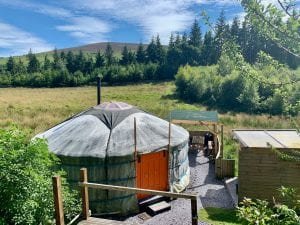 Ty crwn mawr yurt outside old cover 2 off grid sustainable eco glampsite and glamping