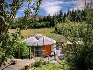 Ty crwn mawr yurt outside old cover 3 off grid sustainable eco glampsite and glamping