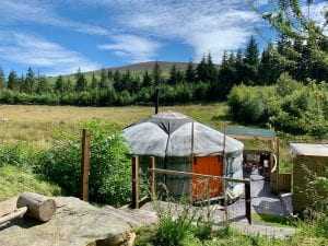 Ty crwn mawr yurt outside old cover 4 off grid sustainable eco glampsite and glamping