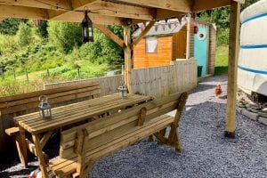 Ty crwn mawr yurt outside covered dining area and fire pit 10 off grid sustainable eco glampsite and glamping