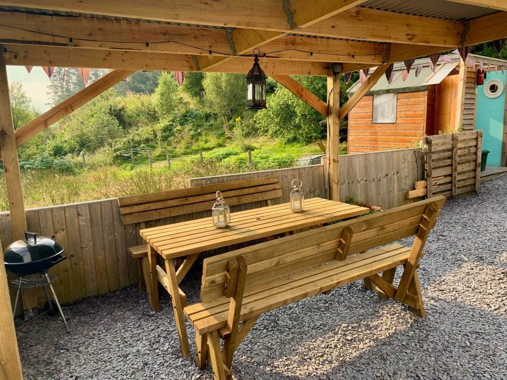 Ty crwn mawr yurt outside covered dining area and fire pit 11 off grid sustainable eco glampsite and glamping