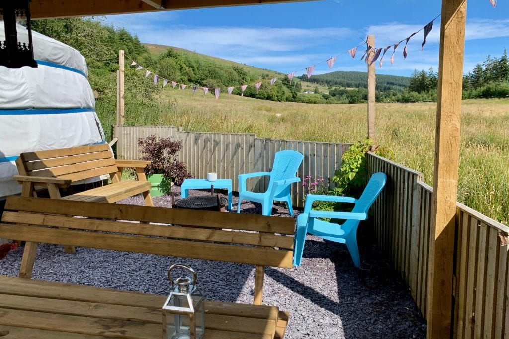 Ty crwn mawr yurt outside covered dining area and fire pit 7 off grid sustainable eco glampsite and glamping