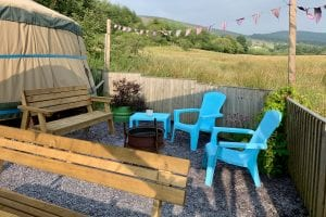 Ty crwn mawr yurt outside covered dining area and fire pit 8 off grid sustainable eco glampsite and glamping
