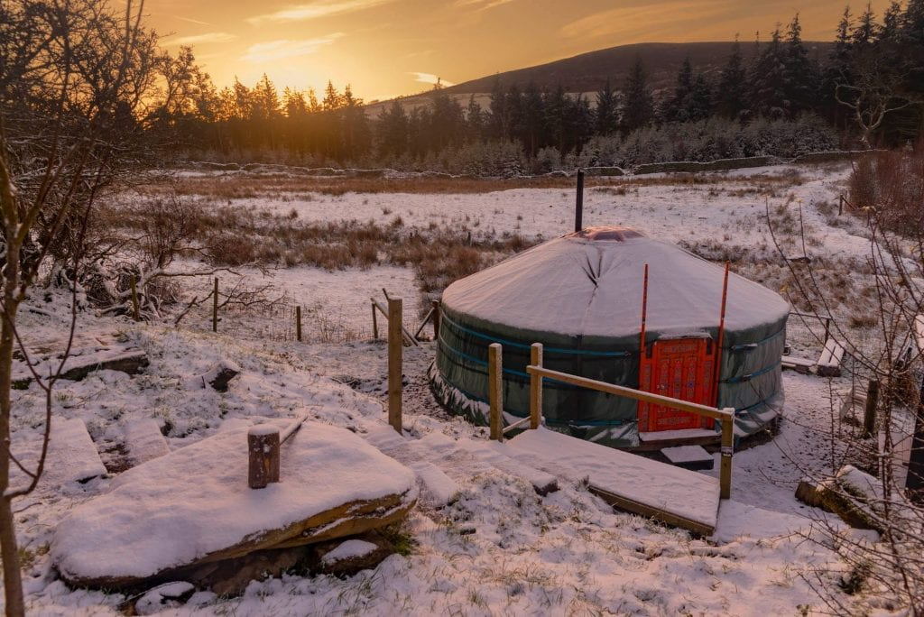 Ty crwn mawr yurt spacious and cosy authentic mongolian yurt exterior in the snow off grid sustainable eco glampsite and glamping