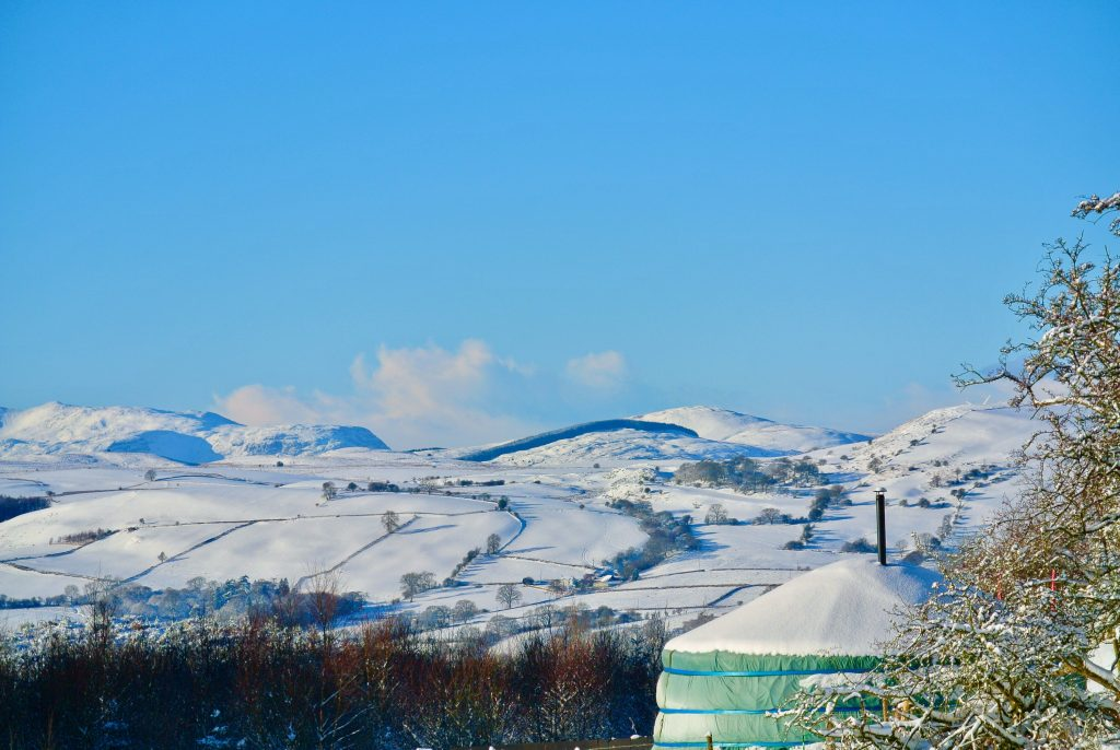 Ty crwn mawr yurt looking out to snowdonia in the winter off grid sustainable eco glampsite and glamping