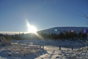 A snowy winter day sunrise over moel henfaes at greener glamping