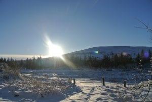 A snowy winter sunrise over moel henfaes