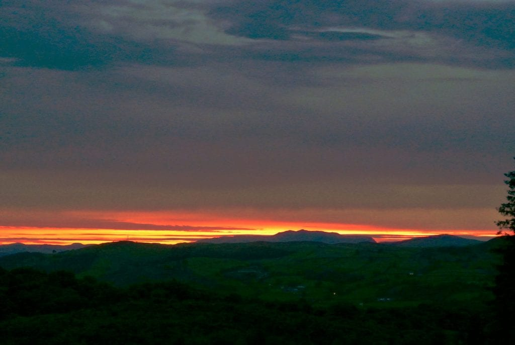 Sunset over arenig vawr off grid sustainable eco glampsite and glamping