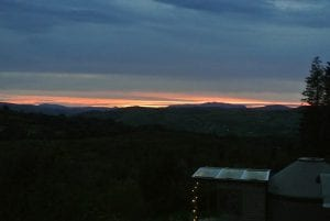 Sunset over ty crwn bach off grid sustainable eco glampsite and glamping