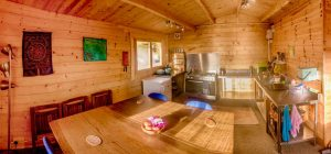 Ty mam mawr log cabin interior off grid sustainable eco glampsite and glamping